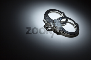 Abstract Pair of Handcuffs Under Spot Light - Text Room