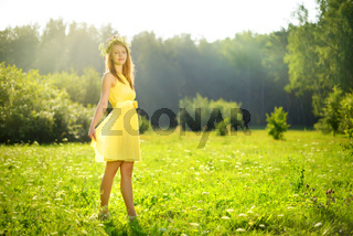 Young attractive girl on a green meadow