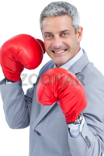 Happy businessman with boxing gloves
