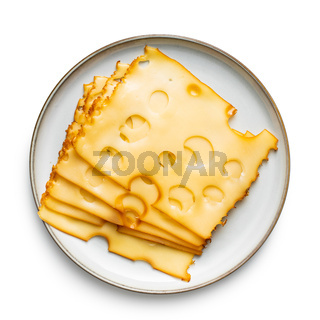 Sliced smoked hard cheese on plate.