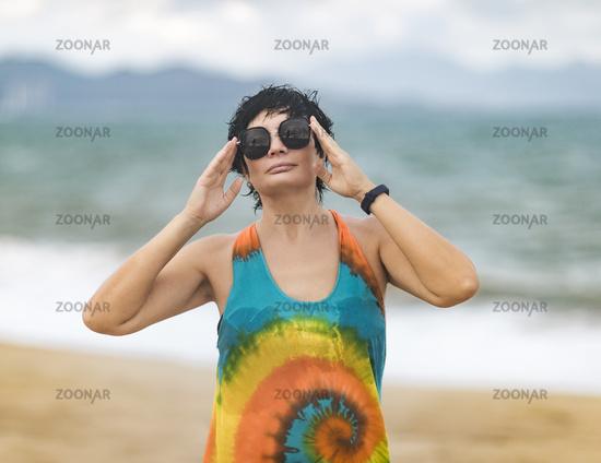 Outdoor portrait of a beautiful woman near the sea