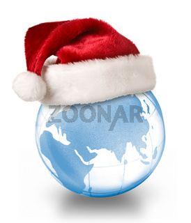 Christmas planet concept - Santa hat on crystal glass globe isolated on white background