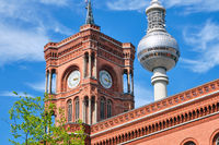 Detail of the tower of the Rotes Rathaus in Berlin with the TV Tower in the back