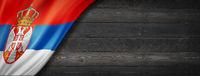 Serbian flag on black wood wall banner
