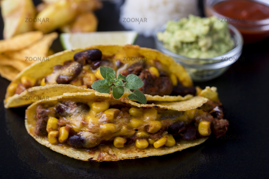 Mexican tacos with rice on slate