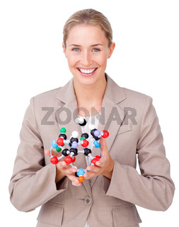 Young businesswoman holding a molecule