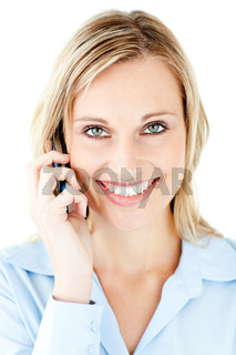 Joyful young businesswoman talking on phone against a white background