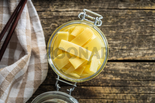 Sliced canned bamboo shoots in jar.