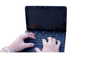 Hände und Laptop/Notebook