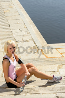 Sport woman body relax sitting stone ground