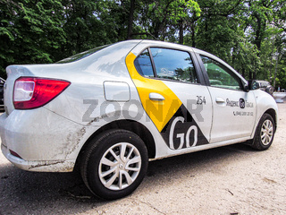 Yandex Go taxi cab is parked on a city street