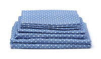 Stack of blue cotton bedding set