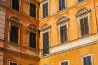 Windows of usual old residential buildings in Rome, Italy