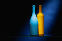 Blue and yellow empty wine bottles.