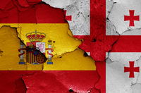 flags of Spain and Georgia painted on cracked wall