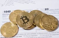 Form 1040 with bitcoin coins for reporting cyber currency gains