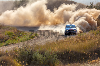 Sports Car on the Turn of the Rally Track and a Lot of Dust 06
