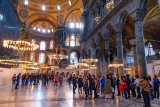 Tourists inside Hagia Sophia, former Orthodox cathedral and Ottoman imperial mosque, in Istanbul, Turkey