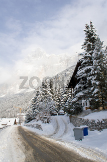 A snow-covered road in the shadow of the Dolomites near Cortina d'Ampezzo