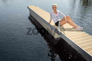 Young sport woman relax on pier water
