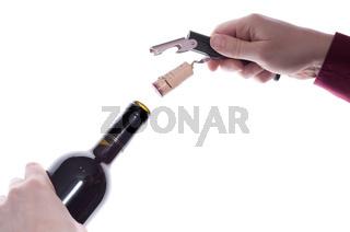 Weinflasche ist mit Korkenzeiher entkorkt
