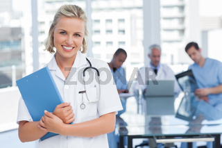 Young nurse holding file