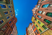 Low angle shot of colorful old tenement buildings in Torun, Poland