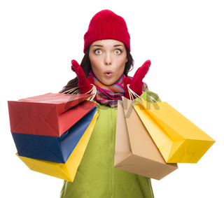 Mixed Race Woman Wearing Hat and Gloves Holding Shopping Bags