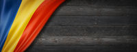 Romanian flag on black wood wall banner