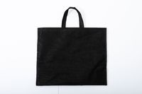 Composition of empty black canvas shopping bag lying flat on white background