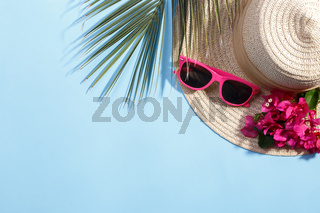 Summer hat on the blue background