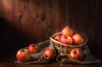 apples  on a dark wooden background in a rustic style