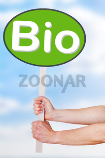 Hands holding a sign with the word bio
