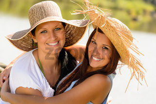 Mother and daughter hugging outdoors summer teen
