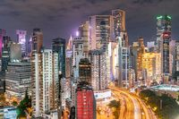 The amazing night and sunset view of cityscape and skyscrapers in Hong-Kong