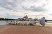 view of the anniversary celebration sculpture of a large metal salmon in the city center of Tornio