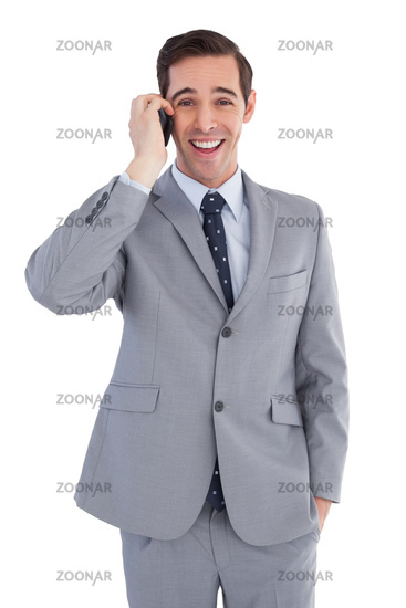 Happy businessman on the phone close up