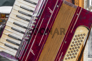 Part view of an old red accordion