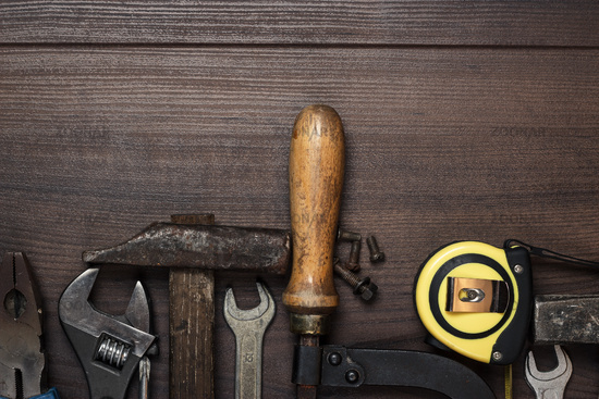 construction instruments on the brown wooden backg