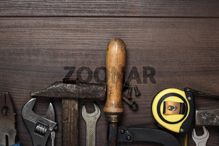 construction instruments on the brown wooden background
