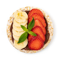 Rice cakes with chocolate paste, strawberry and banana