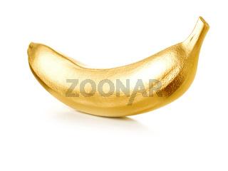 Golden banana isolated on white background.