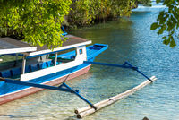 Outrigger boat on the beach of the islet of Poyalisa