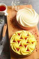 Delicious mini tarts with nuts and custard on wooden cutting board. Assortment of delicious and colorful dessert, lemon curd tart, cream chocolate tart made by chef