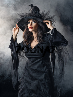 Woman in Halloween witch costume