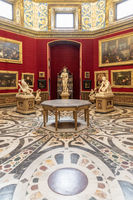 Uffizi Palace in Florence - Firenze, Italy. Ancient statue in Tribuna room.