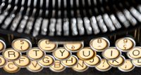 the keys of an old typewriter seen from above