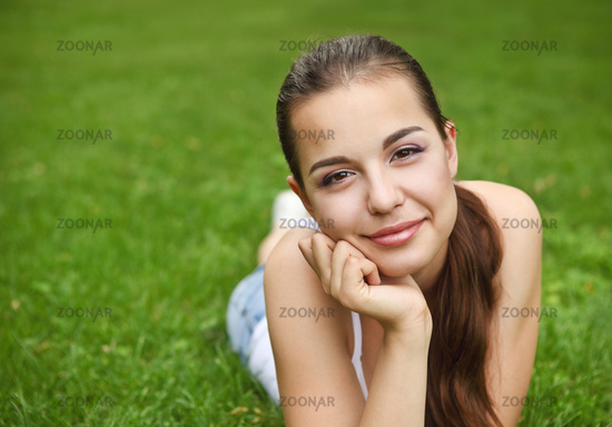 Beautiful young girl in summer park
