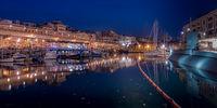 Genoa, Italy - 06 12 2021: View of the old port of Genoa at night, Italy.