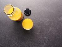 Organic orange juice on a stone table